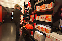 """A Sephora pop-up shop in the trendy Meatpacking District in New York is seen on Wednesday, March 21, 2012. The store, a partnership with Sephora and Pantone promotes the """"Tangerine Tango"""" line of products. The color is the official hue of 2012 chosen by Pantone based on their studies of color trends.  (© Richard B. Levine)"""