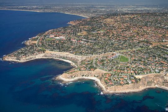 Aerial view of Palos Verdes looking north/northeast with a productive kelp forest in the foreground along the coast.
