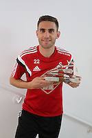 Wednesday 06 May 2015<br /> Pictured: Angel Rangel with his award<br /> Re: Swansea City FC at Fairwood Training Ground.