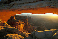 Sunrise light reflecting on Mesa Arch, Island in the Sky District, Canyonlands National Park, Utah