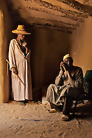 Two men inside one of the homes in the Sahara Desert town of Boujbeja. /Felix Features