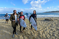 Margaret River, Western Australia. (Sunday April 6, 2014) Kirby Wright (AUS), Tyler Wright (AUS) and caddy Brooke Farris (AUS).–  The 2014 Drug Aware Margaret River Pro World Championship Tour event continued this morning  in 4'-6' waves at the main break of Surfers Point. There was a light wind from the SW that put a bump on the ocean affecting the faces of the waves. The women's event was decided with Carissa Moore (HAW) defeating Tyler Wright (AUS) in a replay of last year's final. In the men's event Round 3 was completed.  Photo: joliphotos.com