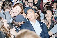 """People clamor to get close to the candidate as entrepreneur and Democratic presidential candidate Andrew Yang greets people and poses for selfies after speaking to a large crowd in Cambridge Common near Harvard Square in Cambridge, Massachusetts, on Mon., September 16, 2019. Yang's unlikely presidential bid is centered on his idea for a """"Freedom dividend,"""" which would give USD$1000 per month to every adult in the United States. After appearing in three Democratic party debates, Yang has risen in polls from longshot candidate to within the top 10."""