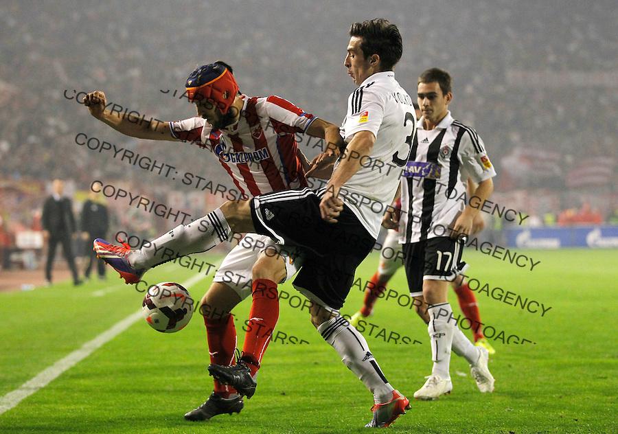Fudbal Super liga season 2013-2014<br /> Crvena Zvezda v Partizan <br /> Milos Ninkovic (L) and Vladimir Volkov<br /> Beograd, 02.11.2013.<br /> foto: Srdjan Stevanovic/Starsportphoto &copy;