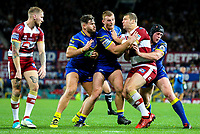 Wigan Warriors' Tony Clubb is tackled by Warrington Wolves' Joe Philbin, Jack Hughes and Chris Hill<br /> <br /> Photographer Alex Dodd/CameraSport<br /> <br /> Betfred Super League Grand Final - Wigan Warriors v Warrington Wolves - Saturday 13th October 2018 - Old Trafford - Manchester<br /> <br /> World Copyright &copy; 2018 CameraSport. All rights reserved. 43 Linden Ave. Countesthorpe. Leicester. England. LE8 5PG - Tel: +44 (0) 116 277 4147 - admin@camerasport.com - www.camerasport.com