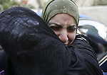 Newly released Palestinian prisoner Sana Salah(C) cry during she hug relatives upon her arrival outside her house in the West Bank city of Bethlehem Oct 2, 2009. Photo by Mohamar Awad