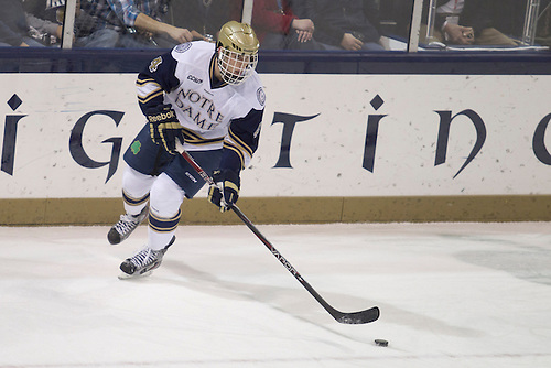 Notre Dame center Riley Sheahan (#4) skates with the puck in action during NCAA hockey game between Notre Dame and Boston College.  The Notre Dame Fighting Irish defeated the Boston College Eagles 3-2 in game at the Compton Family Ice Arena in South Bend, Indiana.