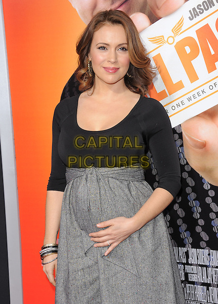 ALYSSA MILANO .at The Warner bros. Pictures' Premiere of ''Hall Pass' held at The Cinerama Dome in Hollywood, California, USA, February 23rd 2011.                                                                                half length black top dress grey gray empire line tied pregnant maternity bracelets .CAP/RKE/DVS.©DVS/RockinExposures/Capital Pictures.