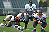 Dakota Dozier #70 of the New York Jets stretches with teammates during the start of a day of team training camp at Atlantic Health Jets Training Center in Florham Park, NJ on Thursday, Aug. 4, 2016.