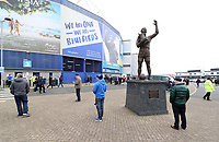A general view of fans around the Frederick Charles 'Fred' Keenor statue with the poster of Cardiff City Manager Neil Warnock celebrating behind him prior to kick off of the Sky Bet Championship match between Cardiff City and Birmingham City at The Cardiff City Stadium, Cardiff, Wales, UK. 11 March 2017