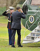 Washington, D.C. - December 4, 2009 -- United States President Barack Obama salutes the Marine Guard as he boards Marine 1 to depart the White House en route to en route to Allentown, Pennsylvania on Friday, December 4, 2009 to discuss jobs and the economy before returning late in the afternoon.Credit: Ron Sachs / Pool via CNP