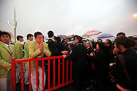 Police officer and security personnel try to keep order as visitors wait in line to enter the China Pavilion during the first day of the trail run for the 2010 World Expo in Shanghai, China..20 Apr 2010
