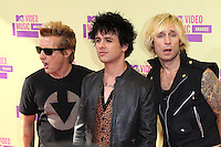 LOS ANGELES, CA - SEPTEMBER 06: Tre Cool, Billie Joe Armstrong and Mike Dirnt at the 2012 MTV Video Music Awards at The Staples Center on September 6, 2012 in Los Angeles, California. © mpi28/MediaPunch inc. /NortePhoto.com<br />