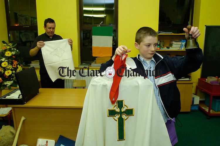Niall Heagney gives a hand to Fr Ger Nash to tidy up after mass at the official opening of the new classroom in Corofin National school. Photograph by John Kelly.