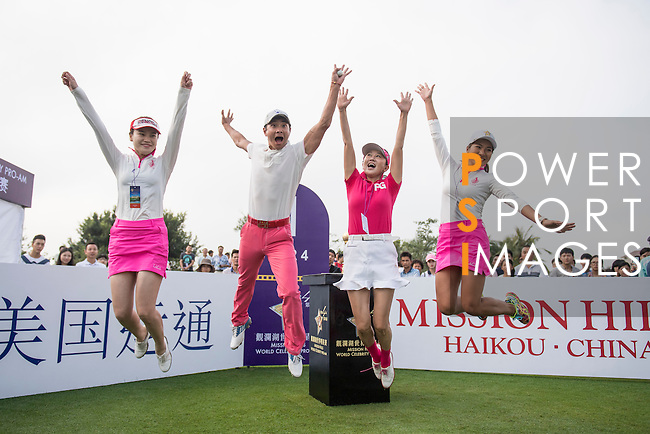Xing Aowei (2nd from left) jump with women at the 1st hole during the World Celebrity Pro-Am 2016 Mission Hills China Golf Tournament on 23 October 2016, in Haikou, China. Photo by Weixiang Lim / Power Sport Images