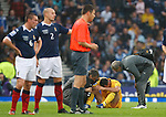 Ilcho Namouski gets treatment for an injury before Scott Brown restarts with a drop ball sparking chaos