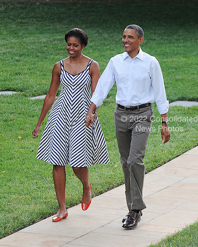 United States President Barack Obama and First Lady Michelle Obama make their way to the Congressional Picnic on the South lawn of the White House, June 15, 2011, in Washington D.C. .Credit: Olivier Douliery / Pool via CNP