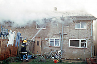 Firefighters attend a severe house fire the fire has already got a hold and smoke can be seen issuing through the roof. This image may only be used to portray the subject in a positive manner..©shoutpictures.com..john@shoutpictures.com