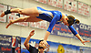 Grace Glennon of West Babylon soars through the air after a vault in the NYSPHSAA varsity gymnastics state championship meet at Cold Spring Harbor High School on Saturday, March 3, 2018.