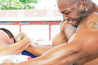Arm wrestler Charles, foreground, during a match at the Staten Island Borough Championship on June 18, 2005.