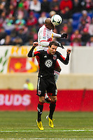 Jamison Olave (4) of the New York Red Bulls goes up for a header with Chris Pontius (13) of D. C. United. The New York Red Bulls and D. C. United played to a 0-0 tie during a Major League Soccer (MLS) match at Red Bull Arena in Harrison, NJ, on March 16, 2013.