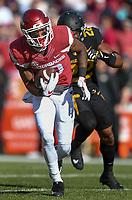 NWA Democrat-Gazette/CHARLIE KAIJO Arkansas Razorbacks wide receiver Jordan Jones (10) runs the ball in the first half during a football game on Friday, November 24, 2017 at Razorback Stadium in Fayetteville.