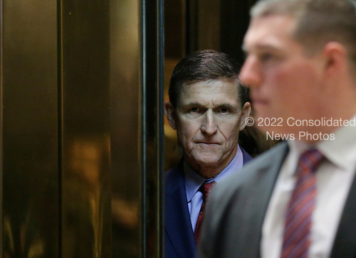 Retired United States Army lieutenant general Michael T. Flynn stands in an the elevator at Trump Tower on December 5, 2016 in New York City. United States President-elect Donald Trump is still holding meetings upstairs at Trump Tower as he continues to fill in key positions in his new administration.  <br /> Credit:John Angelillo / Pool via CNP