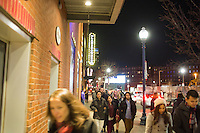 People walk along Lansdowne Street near the House of Blues and Fenway Park in the Fenway neighborhood of Boston, Massachusetts, USA, in the early hours of Saturday, Dec. 5, 2015. There are a number of bars and nightclubs in the area.