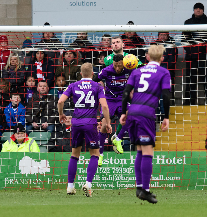 Lincoln City's Grant Smith vies for possession with Grimsby Town's Wes Thomas<br /> <br /> Photographer Chris Vaughan/CameraSport<br /> <br /> The EFL Sky Bet League Two - Lincoln City v Grimsby Town - Saturday 19 January 2019 - Sincil Bank - Lincoln<br /> <br /> World Copyright &copy; 2019 CameraSport. All rights reserved. 43 Linden Ave. Countesthorpe. Leicester. England. LE8 5PG - Tel: +44 (0) 116 277 4147 - admin@camerasport.com - www.camerasport.com