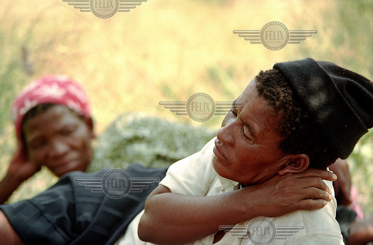 Bushman women of the Central Kalahari Game Reserve return to their ancestral land after winning the court case against the Botswana government who illegally evicted them in 2002.