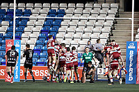 Picture by Paul Greenwood/SWpix.com - 27/04/2018 - Rugby League - Betfred Super League - Widnes Vikings v Wigan Warriors - Select Security Stadium, Widnes, England - Wigan Warriors players celebrate the final try by Taulima Tautai