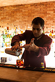 BRAZIL, Rio de Janiero, a bartender pours a drink at the bar inside of Hotel Fasano