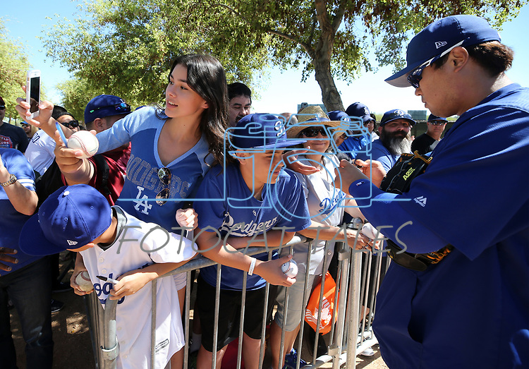 Los Angeles Dodgers fans get autographs from Hyun-Jin Ryu before a spring training game in Glendale, Ariz., on Friday, March 24, 2017.<br /> Photo by Cathleen Allison/Nevada Photo Source