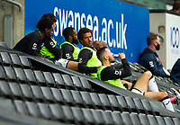 18th July 2020; Liberty Stadium, Swansea, Glamorgan, Wales; English Football League Championship, Swansea City versus Bristol City; Wayne Routledge of Swansea City sits with the rest of the substitutes in the stand