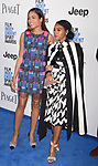 SANTA MONICA, CA - FEBRUARY 25: Actress Naomie Harris (L) and actress/singer Janelle Monae attend the 2017 Film Independent Spirit Awards at the Santa Monica Pier on February 25, 2017 in Santa Monica, California.
