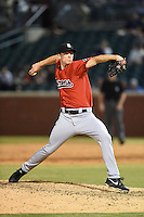 Birmingham Barons pitcher Cody Winiarski (35) delivers a pitch during a game against the Chattanooga Lookouts on April 24, 2014 at AT&T Field in Chattanooga, Tennessee.  Chattanooga defeated Birmingham 5-4.  (Mike Janes/Four Seam Images)