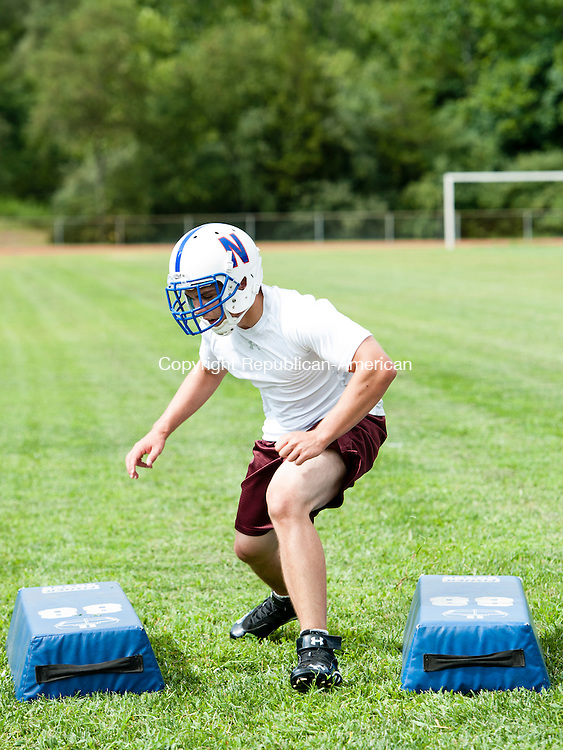 WOODBURY, CT-15 August 2014-081514EC02-  Captain Elijah Gonillo practices Friday afternoon. Nonnewaug football had its best year last year, going 4-7. Erin Covey Republican-American