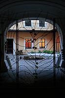 Courtyard in black frame.