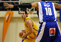 Taranaki forward Aaron Bailey-Nowell looks for a way round Leon Henry during the National basketball league match between the Wellington Saints  and Taranaki Mountainairs at TSB Bank Arena, Wellington, New Zealand onFriday, 9 April 2010. Photo: Dave Lintott / lintottphoto.co.nz