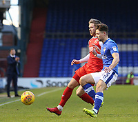 Fleetwood Town's Wes Burns (left)  and Oldham Athletic's Rob Hunt (right) in action during the Sky Bet League 1 match between Oldham Athletic and Fleetwood Town at Boundary Park, Oldham, England on 26 December 2017. Photo by Juel Miah / PRiME Media Images.