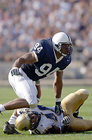 04 September 2004:  Derek Cameron Wake (94), of Penn State runs past Akron's (40)..Penn State defeated Akron 48-10 during their season opener 9-4-04 at Beaver Stadium in State College, PA. Credit: Photo by Randy Litzinger..