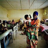 21 year old Sarama and her 10 month old baby Jedite born as a result of her rape, in hospital in Goma. An estimated 250,000 women have been victims of sexual violence during the Democratic Republic of Congo's civil war. In the eastern states of the country a recent peace agreement struggles to keep warring factions from fighting, and as the chaos that accompanies war continues, so does the rape of women in the area..©Robin Hammond/PANOS/Felix Features