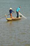 Asia, Vietnam, Hoi An. Fisher on the Thu Bon river near Hoi An.