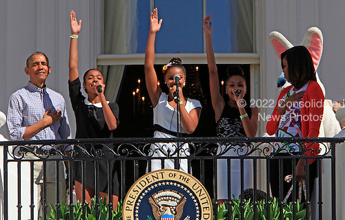 United States President Barack Obama and First Lady Michelle Obama and the group  ID4GIRLS participate in the White House Easter Egg Roll on the South Lawn on April 6,2015.<br /> Credit: Dennis Brack / Pool via CNP