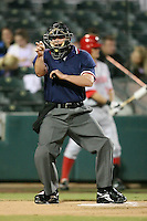 April 14, 2009:  Home plate umpire Jordan Ferrell during a game at Roger Dean Stadium in Jupiter, FL.  Photo by:  Mike Janes/Four Seam Images