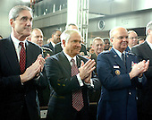 """Washington, D.C. - February 20, 2007 -- Federal Bureau of Investigation (FBI) Director Robert Mueller, left, United States Secretary of Defense Robert Gates, center, and Central Intelligence Agency (CIA) Director Michael Hayden, right, applaud as United States President George W. Bush makes remarks prior to the Ceremonial Swearing-in for retired Vice Admiral John Michael """"Mike"""" McConnell as the second Director of National Intelligence (DNI) in Washington, D.C. on Tuesday, February 20, 2007.  McConnell replaces John Negroponte.<br /> Credit: Ron Sachs - Pool"""