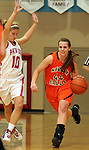 SIOUX FALLS, SD - JANUARY 22:  Ellie Benson #44 from Washington pushes the ball up court past Darby Hugunin #10 from Lincoln in the second half of their game Tuesday night at Lincoln. (Photo by Dave Eggen/Inertia)