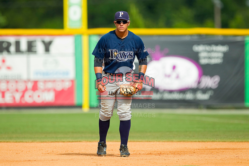 Princeton Rays first baseman Travis Flores (20) on defense against the Burlington Royals at Burlington Athletic Park on July 5, 2013 in Burlington, North Carolina.  The Royals defeated the Rays 5-1 in game one of a doubleheader.  (Brian Westerholt/Four Seam Images)