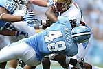 01 September 2012: Elon's Tracey Coppedge (22) is tackled by UNC's Kevin Reddick (48). The University of North Carolina Tar Heels played the Elon University Phoenix at Kenan Memorial Stadium in Chapel Hill, North Carolina in a 2012 NCAA Division I Football game.
