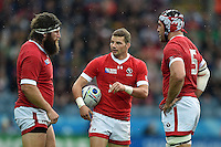 Gordon McRorie of Canada has a word with team-mates Hubert Buydens and Jamie Cudmore. Rugby World Cup Pool D match between Canada and Romania on October 6, 2015 at Leicester City Stadium in Leicester, England. Photo by: Patrick Khachfe / Onside Images